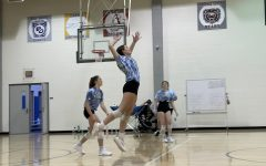 Women's varsity volleyball player and senior Ella Brooks jumps into the air to hit a volleyball during practice. After winning against Jasper High School's volleyball team and losing to Providence High School's volleyball team, CHS women's varsity volleyball team is working hard for their next match on Sept. 13 at CHS against Westfield High School's women's volleyball team.