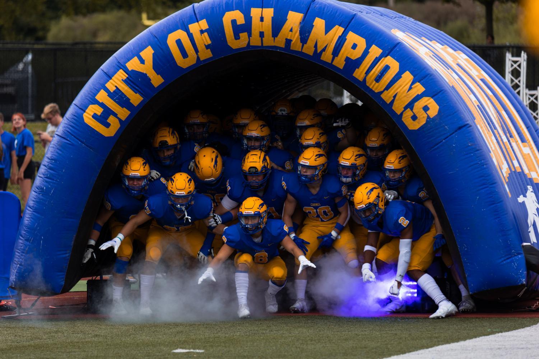 Varsity football players keep same game mindset despite bigger Homecoming crowds
