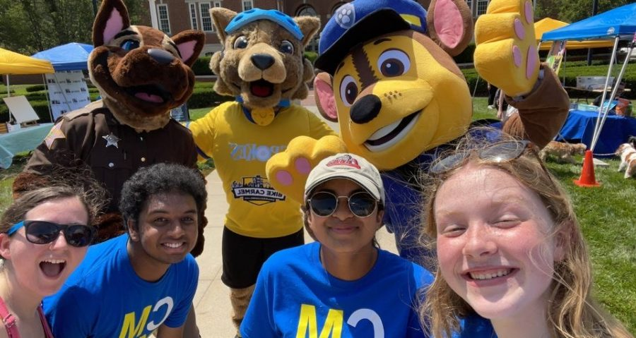 President Manav Musunuru (second from left) poses with members of Carmel Mayor's Youth Council (CMYC) and mascots at the Carmel Farmers Market. CMYC regularly volunteers to help with bike parking at the Carmel Farmers Market.