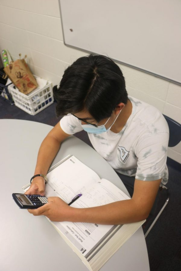 Junior Elliott Shi takes a SAT practice test. Shi said, It would make more sense to require SAT, ACT tests to prepare students.