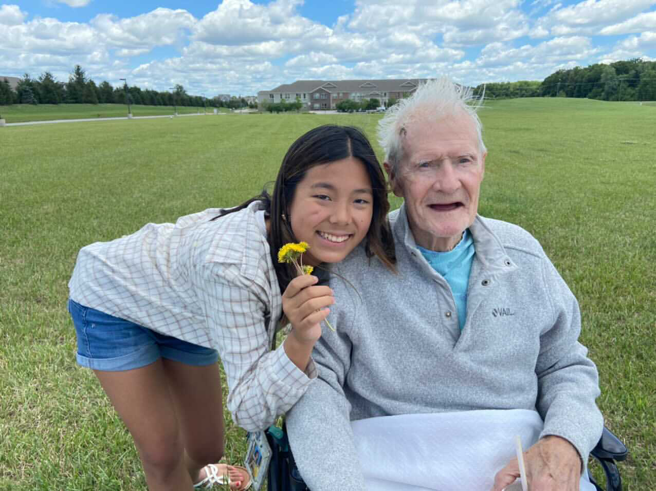 Junior Katie O'Daniel poses with her grandfather outside of their home on the yard. She said she likes the family aspect and increased time she gets to spend as a family because of his presence.