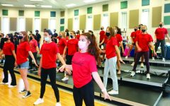 Creative Choreo: The Ambassador choir members practice their routines in a gym. The fall performance will be on Sept. 29.
