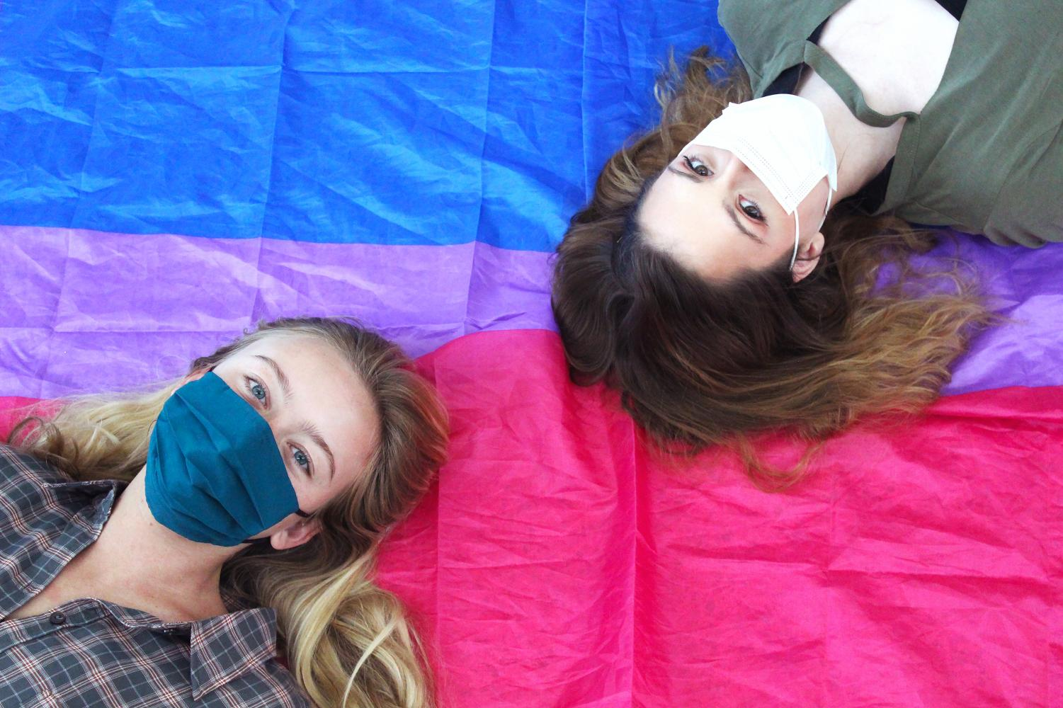 Junior Marielle Cortelyou and senior Annie Salter pose with a bisexual flag. Cortelyou, the president of the Gender and Sexuality Alliance, said she believed Bisexual Pride Day was a validating occasion.
