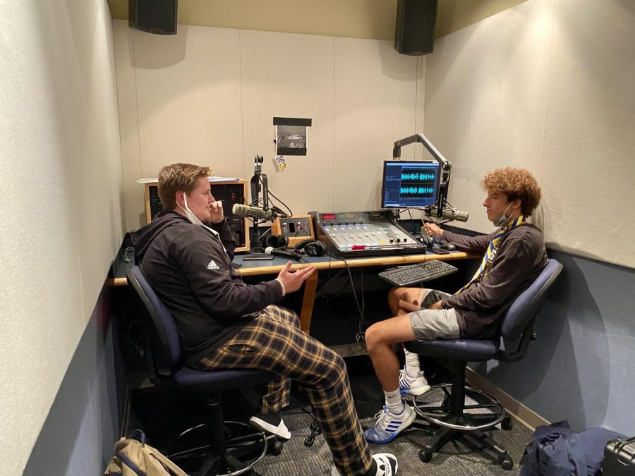 """Sean Grove, events manager and senior, speaks with Zach Browning, co-sports director and senior, in a live studio during class. Grove, who is in charge of planning for Ghosts and Goblins 5k/2k said, """"(WHJE) provide (s) microphones, setups, and all the music thats going on there this year. Well have Scott Sander there, who is actually on the news. He'll be the emcee for the day, and we'll get to meet him and stuff like that so that will be really cool."""""""