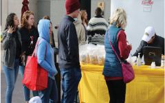 Customers of the Carmel Farmers Market stand in line to buy items. The market is open most Saturdays with the exception of Dec. 25 and Jan. 1 from 9 a.m to noon. Photo by Christian Ledbetter