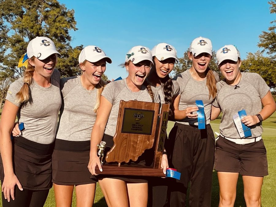 Members of the women's varsity golf team celebrate their victory at the IHSAA Regional on September 24. According to assistant coach Dan Patane, the team has a shot at winning the State Final on October 1-2.  (Photo from @CarmelGolfGirls on Twitter)