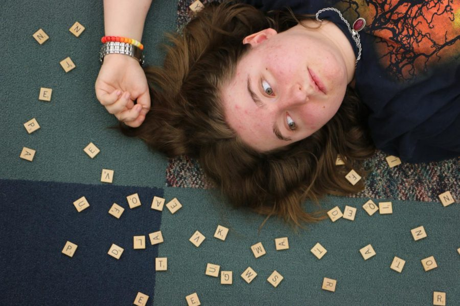 Sophomore Cecilia Pike poses with Scrabble tiles. She said she wished people would be more empathetic around people who stutter.