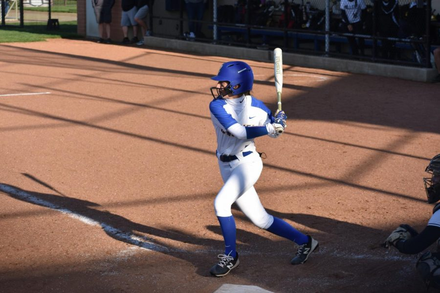 Ella Ohrvall, softball player and senior, prepares to swing while at bat during a game. Ohrvall, who verbally  committed to DePauw University, said she plans on signing a National Letter of Intent in November to officially commit to DePauw.