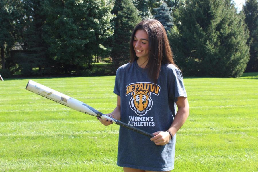 Ella Ohrvall, softball player and senior, holds a bat while wearing a shirt from DePauw University. Ohrvall said COVID-19 forced her to communicate with coaches entirely virtually.